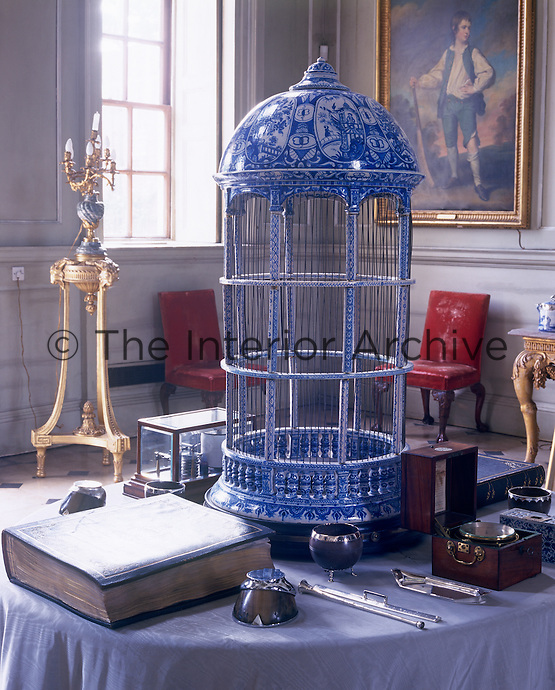 A Delft birdcage s a focal point on the table in the entrance hall