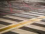 Trolly tracks, intersection, crosswalk stripes, In the streets, Alexander Bulivard, Belgrade, Serbia
