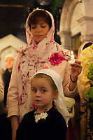Switzerland. Geneva. Easter at the Russian Church. The church is a lovely 19th-century Russian Orthodox church and designed in a Byzantine Moscovite style. The church's full name is Cathédrale de l'Exaltation de la Sainte Croix. A mother and her daughter, both with a scarf on their heads, hold candles in hands on the night of Easter Sunday. The nighttime liturgy is a blessing of Easter fire with candles and the celebration of the Easter Proclamation of the Resurrection of Jesus Christ. Easter, also called Pascha or Resurrection Sunday is a festival and holiday celebrating the resurrection of Jesus from the dead, described in the New Testament as having occurred on the third day of his burial after his crucifixion.The Russian church serves not only the Russian community but also Bulgarians, Serbs, Coptic Christians and other Orthodox worshippers who do not have their own church in Geneva. 16.04.17 © 2017 Didier Ruef