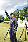 Old Bethpage, New York, USA - July 21, 2012: At far right, WILLIAM (BILL) CARMAN of Wantagh, NY, whose great-grandfather, John Carman, was member of Co. H in Civil War, points sword, which is not used as weapon, to show direction troops should go, during re-creation of Life in Camp Scott, a Union Army training camp, at Old Bethpage Village Restoration, to commemorate 150th Anniversary of American Civil War, on Saturday, July 21, 2012.