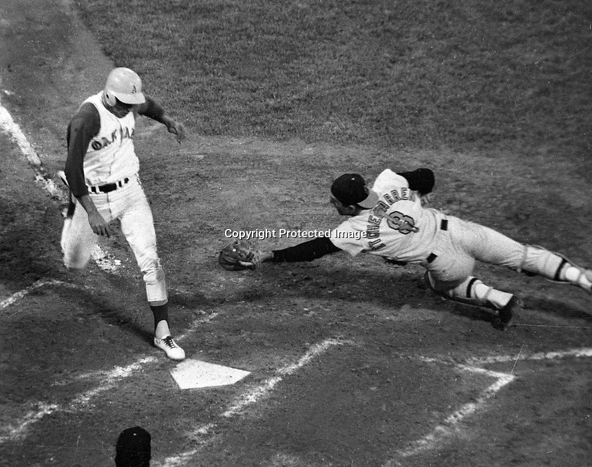 Oakland Athletics Rick Monday scores as Baltimore's Andy Etchebarren late tag.(1968 photo by Ron Riesterer.