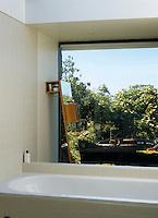 This simple bathroom has views over the garden