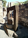 olive oil press at Kursi, Israel Kursi is the Arabic name for the ruin on the eastern shores of the Sea of Galilee, Israel. During the mishnaic and talmudic periods this was a Jewish fishing village. Excavations revealed the remnants of the largest Byzantine-period monastery in Israel (123 by 145 meters). The monastery and the church inside it were built in the middle of the fifth century C.E. In the church, archeologists found a mosaic floor with pictures of animals (chickens, geese, doves, cormorants, and fish), and plants such as citrons, dates, pomegranates, and grapes. According to the New Testament, Jesus healed a man possessed by demons in Kursi. Mark relates that when Jesus disembarked from his boat, a &quot;man with an evil spirit came from the tombs to meet him.&quot; A herd of swine was grazing in the area and Jesus cast the demonic spirits from the man to the swine. The swine then ran into the Sea of Galilee and drowned (Mark 5: 1-20)