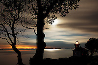 Lime Kiln Lighthouse stands watch over Haro Strait at dawn, Washington