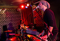 Scott Simons, vocalist/keyboards, and Dani Buncher, vocalist/drummer, of indie/pop Pittsburgh-based band, TeamMate, perform during their show with fellow Rostrum Records band Donora at Brillobox in the Bloomfield neighborhood of Pittsburgh, Pennsylvania on February 10, 2012.