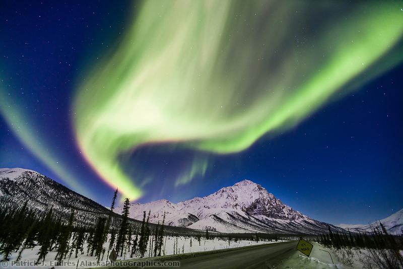 Aurora borealis over Mount Dillon, Brooks range, James Dalton highway, Alaska.