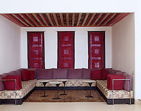 A modern take on traditional Moroccan-style seating in this alcove which uses fabric and wall hangings