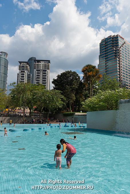 Kids Play In The Lake Of KLCC Park, Kuala Lumpur, Malaysia