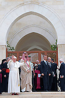 Pope Benedict XVI waving to the crowd during his visit to the Regina Pacis Church in Amman, Jordan on 08 May 2009. Pope Benedict XVI is on his first visit to the region as pontiff. After Jordan, the Pope's tour will take him to Israel and the West Bank