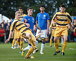 Graham Fraser cuts out the ball as Ross Perry waits