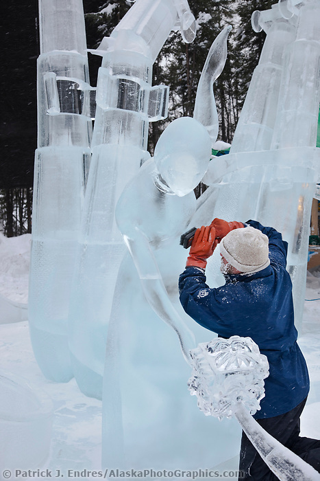 """Ice artist Vladimir Zhikhartsev works on """"Pandoras Box"""" a multi-block sculpture that earned first place in the abstract category, 2009 World Ice Art Championships, Fairbanks, Alaska"""