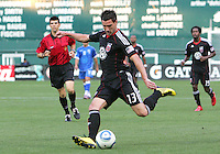 Chris Pontius #13 of D.C. United sends over a pass during an international charity match against the national team of El Salvador at RFK Stadium, on June 19 2010 in Washington DC. D.C. United won 1-0.