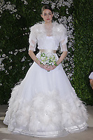 Model walks runway in a Annaleise wedding dresses by Carolina Herrera, for the Carolina Herrera Bridal Spring 2012 runway show.