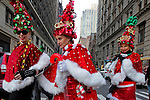 Women dressed in merry Christmas characters take part at the Santacon's Annual Festival at Manhattan in New York, United States. 14/12/2012. Photo by ZAMEK