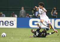 Rodney Wallace #22 of D.C. United slides under Pato #7  of A.C.Milan during an international friendly match at RFK Stadium, on May 26 2010 in Washington DC. United won 3-2.