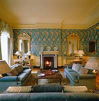 In this drawing room a precise hand and bold eye for colour have been at work creating a cohesive statement from a variety of contrasting patterns and textiles