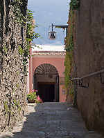 Narrow street in Ravello, Amalfi Coast, Italy. Lamp over street.