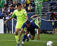 Seattle Sounders FC defender Leonardo Gonzalez, left, defens against Manchester United midfielder Nani during play at CenturyLink Field in Seattle Wednesday July 20, 2011. Manchester United won the match 7-0.