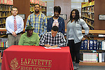 Lafayette High's Keeyon Tyson (36) signs a National Letter of Intent to play football at Itawamba Community College, in Oxford, Miss. on Wednesday, February 1, 2012.
