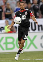 WASHINGTON, DC - AUGUST 4, 2012:  Nick DeLeon (18) of DC United pulls in a high cross against the Columbus Crew during an MLS match at RFK Stadium in Washington DC on August 4. United won 1-0.