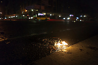 Flares burn at a dark intersection in the Chelsea neighborhood of New York on Tuesday, October 30, 2012. Hurricane Sandy roared into New York disrupting the transit system and causing widespread power outages. Con Edison is estimating it will take four days to get electricity back to Lower Manhattan. (© Richard B. Levine)