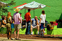 Photography of Charlotte NC's Plaza Midwood neighborhood. Plaza-Midwood is located about one mile northeast of Charlotte's Center City area. It is roughly bounded by Hawthorne Lane, The Plaza, Briar Creek Road and Central Avenue. Locally, Plaza Midwood is considered one of Charlotte's most diverse and eclectic neighborhoods for its art galleries, restaurants and clever retail offerings. Photo shows customers enjoying a sunny day at Zada Jane's Corner Cafe.