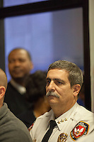 Durham Police Chief Lopez watches from the back of the room as his administration reads a prepared summary and narrative of the department's investigation into the alleged suicide of Jesus Huerta, 17, while in police custody on November 19, 2013 at police headquarters in Durham, N.C. on Friday, January 10, 2014. (Justin Cook)