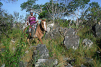 "Small farmer riding hose in ""campos rupestres"", rock outcrop in savanna (cerrado)."
