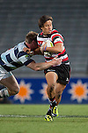 Tim Nanai Williams tries to fight his way out of Tom McCartney's tackle. ITM Cup Round 7 rugby game between Auckland and Counties Manukau, played at Eden Park, Auckland on Thursday August 11th..Auckland won 25 - 22.