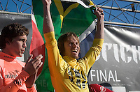 """Grant """"Twiggy"""" Baker holds up a South African flag standing next to Greg Long on stage during the awards ceremony at the 2008 Mavericks Surf Contest in Half Moon Bay, Calif., Saturday, January 12, 2008...Photo by David Calvert/isiphotos.com"""