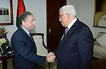 Palestinian President Mahmoud Abbas meets with the President of the Federation International Motor Sports Jean Todt at the Palestinian Authority headquarter in the West Bank city of Ramallah on Oct. 31, 2012. Photo by Thaer Ganaim