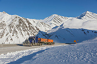 Industrial trucker travels the James Dalton Highway through Atigun Pass, Brooks Range, Alaska.