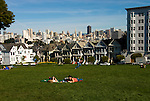 California: San Francisco. People relaxing in Alamo Square with view of Victorians and modern downtown. Photo copyright Lee Foster. Photo #: san-francisco-alamo-square-20-casanf77485