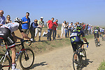The peloton on pave sector 29  Troisvilles a Inchy during the 115th edition of the Paris-Roubaix 2017 race running 257km Compiegne to Roubaix, France. 9th April 2017.<br /> Picture: Eoin Clarke | Cyclefile<br /> <br /> <br /> All photos usage must carry mandatory copyright credit (&copy; Cyclefile | Eoin Clarke)