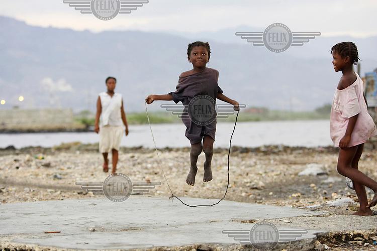 A girl skips in the Cite Soleil slum.