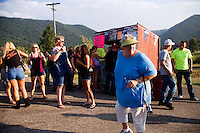 People gather at the entrance gate to the Testicle Festival at the Rock Creek Lodge in Clinton, MT.  Bringing alcohol to the Festival was forbidden, so many had to drink their alcohol before entering the festival area. The Rock Creek Lodge in Clinton, MT, has hosted the annual Testicle Festival since the early 1980s.  The four day festival and party revolves around the consumption of so-called Rocky Mountain Oysters, which are deep-fried bull testicles.