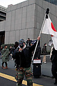 March 11, 2012, Tokyo, Japan - A right wing Japanese man shouts at protesters as he holds a Japanese flag. Many protesters carrying banners took to the streets of Tokyo to demonstrate against nuclear power on the first anniversary of the Great East Japan Earthquake.  (Photo by Rodrigo Reyes Marin/AFLO) (JAPAN)