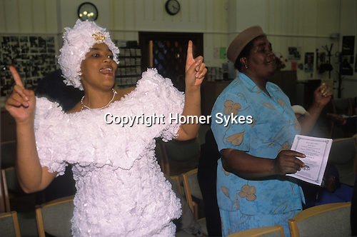 Church of God of Prophecy west London. Spiritual dancing. from A STORM IS PASSING OVER a Look at Black Churches in Britain. Published by Thames and Hudson isbn 0 500 27826 1