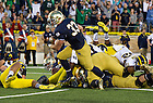 Sept. 6, 2014; Irish running back Cam McDaniel charges to the end zone to score a touchdown in the first half against Michigan. (Photo by Barbara Johnston/ University of Notre Dame)