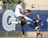Tommy Muller #8 of Georgetwn University leaps over Daniel Gonzalez #22 of Villanova University during a Big East match at North Kehoe Field, Georgetown University on October16 2010 in Washington D.C. Georgetown won 3-1.