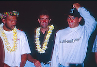 Kelly Slater (USA) with Barton Lynch (AUS) and Sunny Garcia (HAW). Slater won the 1992 Mauri Pipline Masters and was also  crowned 1992 World Surfing Champion. With this title he became the youngest ever World Champion..Photo: www.joliphotos.com