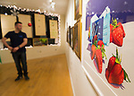 A young man looks at paintings, including one of large strawberries, displayed at the Jingle Boom Holiday Bash, at the Main Street Gallery of Huntington Arts Council. Sparkboom, an HAC project, provides events such as this geared to Gen-Y, 18-34 years of age, to address the 'brain drain' of creative young professionals of Long Island. The paintings were the Annual Juried Still Life Show 'Inanimate.'