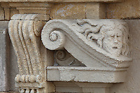 Sculptural detail of a scroll and face on the Phare de Cordouan or Cordouan Lighthouse, built 1584-1611 in Renaissance style by Louis de Foix, 1530-1604, French architect, located 7km at sea, near the mouth of the Gironde estuary, Aquitaine, France. This is the oldest lighthouse in France. There are 4 storeys, with keeper apartments and an entrance hall, King's apartments, chapel, secondary lantern and the lantern at the top at 68m. Parabolic lamps and lenses were added in the 18th and 19th centuries. The lighthouse is listed as a historic monument. Picture by Manuel Cohen