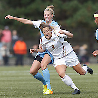 Late in the game, University of North Carolina defender Hanna Gardner (71) earns a yellow card. Boston College forward Stephanie McCaffrey (9) on the attack.   University of North Carolina (blue) defeated Boston College (white), 1-0, at Newton Campus Field, on October 13, 2013.