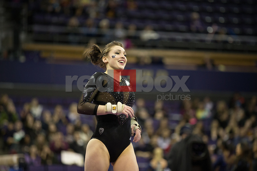 The University of Washington gymnastics team hosts a meet against UCLA at Alaska Airlines Arena on Sunday, February 16, 2014 (Photo by Max Waugh/Red Box Pictures)