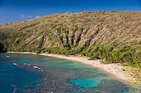 The coral reef and white sand beach at Hanauma Bay Nature Preserve, O'ahu