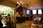 Brunch at Simpatica, a catering company that offers dinner on Friday and Saturday nights, plus a Sunday Brunch.  Located in SE Portland, Oregon. The dining hall is adjacent to the open kitchen and offers communal seating.