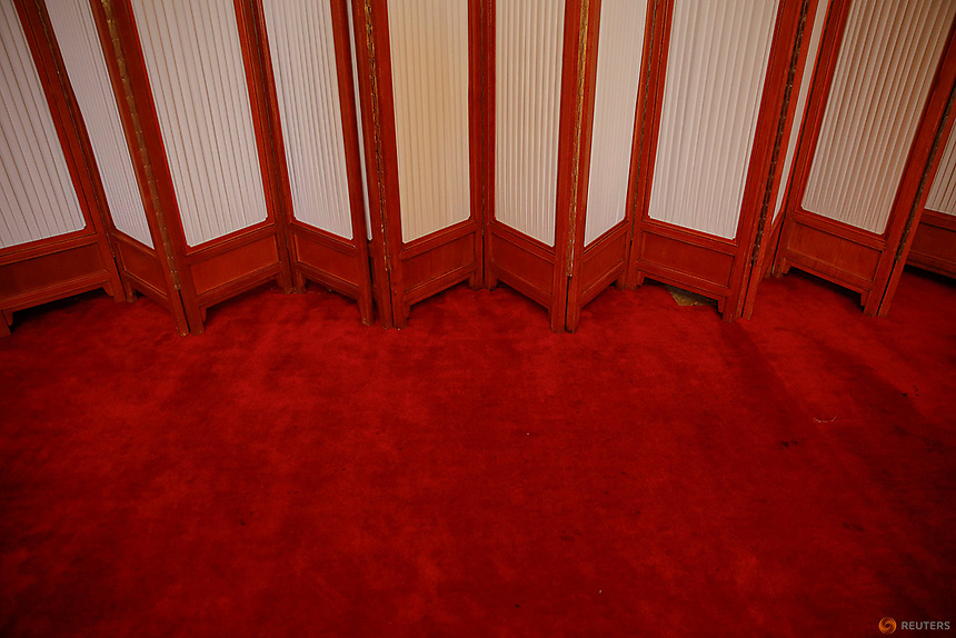 A screen divides a room inside the Great Hall of the People where sessions of the National People's Congress (NPC) and the Chinese People's Political Consultative Conference (CPPCC) are taking place, in Beijing, China March 7, 2016.   REUTERS/Damir Sagolj