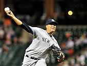 New York Yankees pitcher Hector Noesi (64) pitches in the ninth inning against the Baltimore Orioles at Oriole Park at Camden Yards in Baltimore, Maryland in the second game of a doubleheader on Sunday, August 28, 2011.  The Yankees won the game 8 - 3, earning a split in the two games..Credit: Ron Sachs / CNP.(RESTRICTION: NO New York or New Jersey Newspapers or newspapers within a 75 mile radius of New York City)