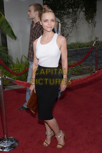 """CHRISTINA RICCI.At the """"Hustle & Flow"""" Los Angeles Film Premiere,.held at the Arclight Cinerama Dome, .Hollywood, California, USA, 20th July 2005..full length white vest tank top black skirt skinny thin tattoo tucked in diamante ankle strap shoes orange brown clutch bag.Ref: ADM.www.capitalpictures.com.sales@capitalpictures.com.©Zach Lipp/AdMedia/Capital Pictures."""